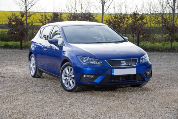 The front exterior of a blue Seat Leon