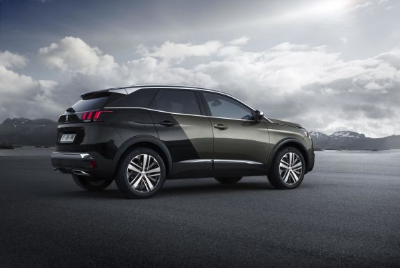 The side exterior of a black Peugeot 3008
