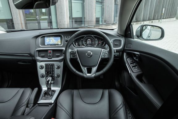 The interior of a Volvo V40 with steering wheel and dashboard in shot
