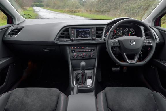 The interior of a Seat Leon with steeringwheel and dashboard in shot
