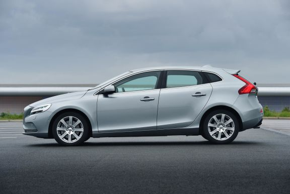 The side exterior of a white Volvo V40