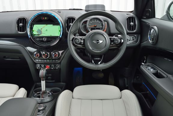 The interior of a Mini Countryman with steering wheel and dashboard in shot