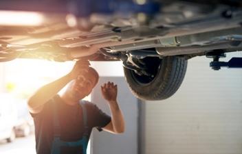 A Cazoo technician inspecting a Cazoo car